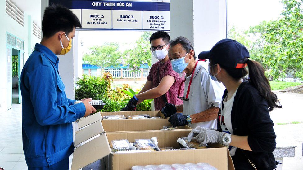 Mr Ngo helping to provide meals to camps