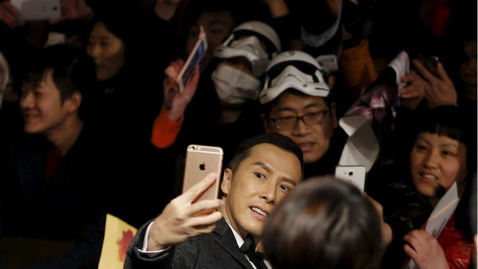 """Hong Kong actor Donnie Yen takes a selfie at the Shanghai premiere of the """"The Force Awakens"""""""