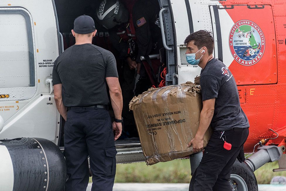US Coast Guard carry medical supplies to the Ofatma Hospital in Les Cayes, Haiti, on 17 August 2021