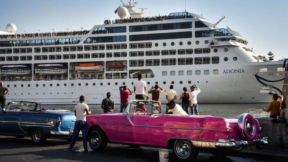 Cubans watch as the first US-to-Cuba cruise ship to arrive in the island nation in decades glides into the port of Havana, on May 2, 2016.