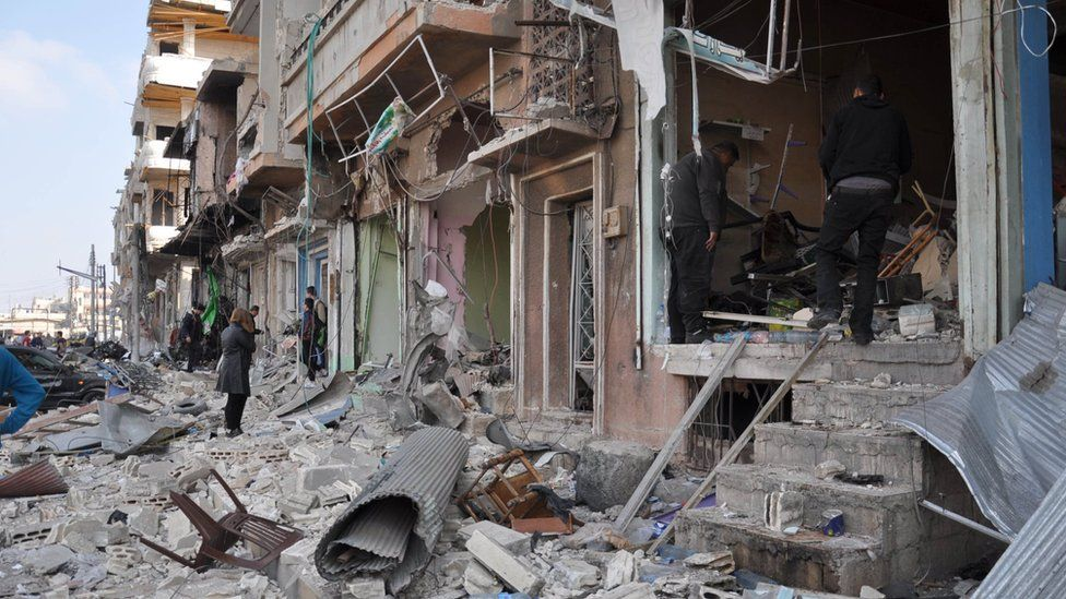 Damaged buildings following a twin suicide bombing in Syria