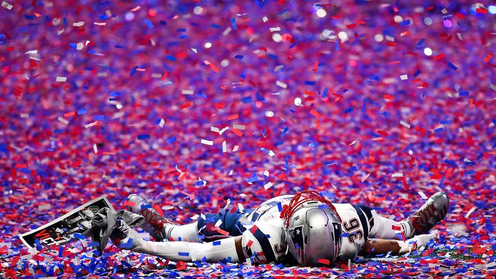 New England Patriots linebacker Brandon King (36) lays in the confetti after Super Bowl LIII