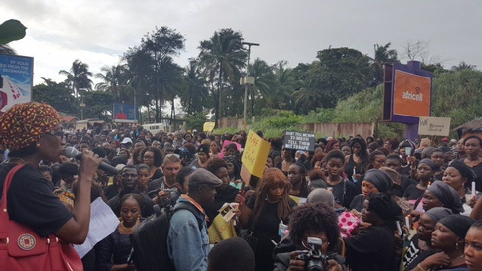 Crowd gathered at the spot where Hannah Bockarie's body was found in Sierra Leone's capital, Freetown.