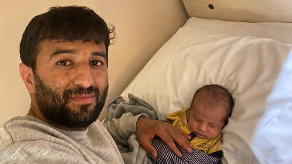 Khalid and his baby in the UK