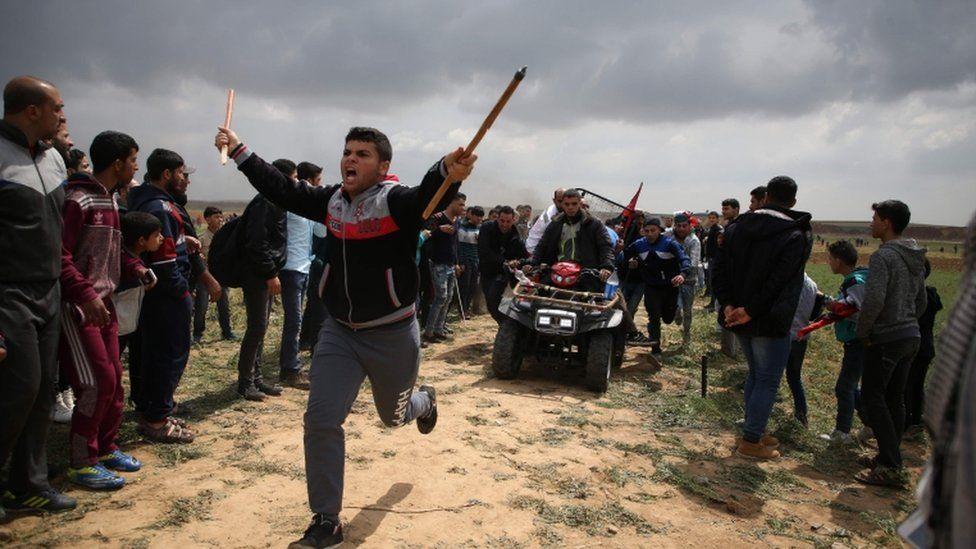 An injured protester is evacuated from Jabaliya