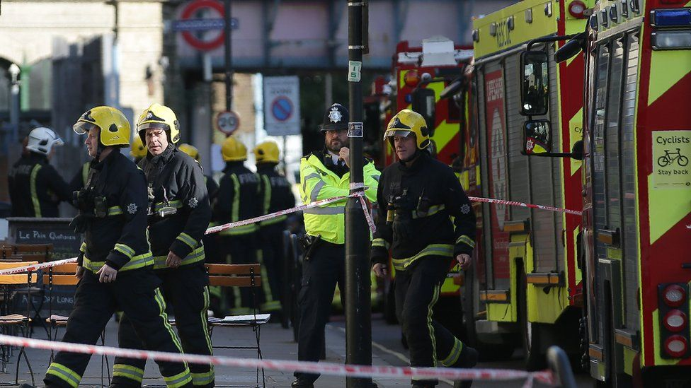 Firefighters outside Parsons Green