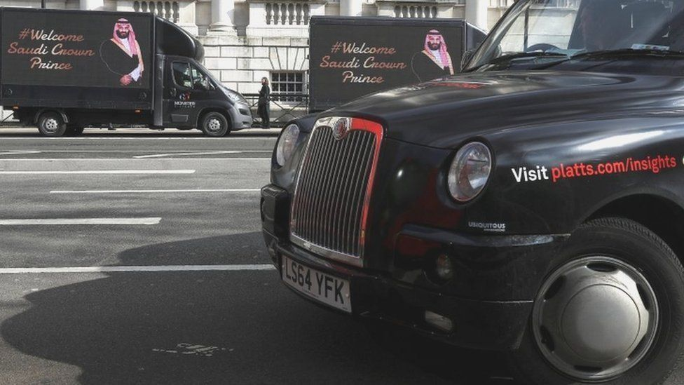 Other vans parked in Whitehall feature a welcome to the Saudi crown prince