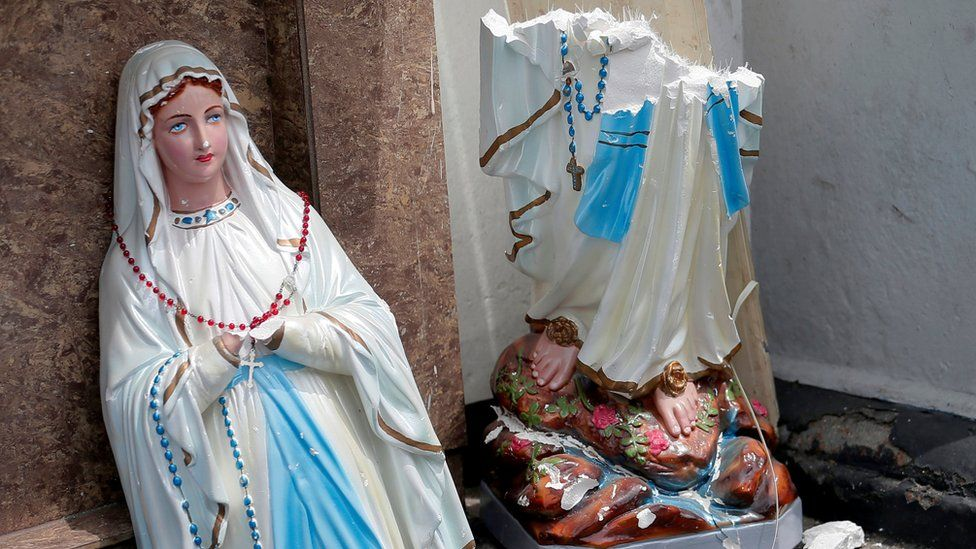 A statue of Virgin Mary broken in two parts at the St. Anthony's Shrine, Kochchikade church in Colombo