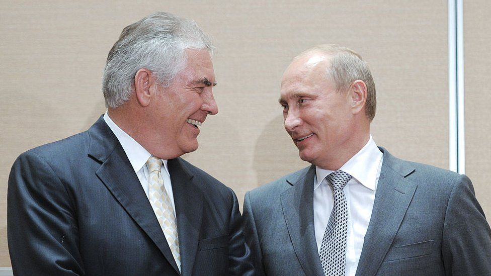 Russia's Prime Minister Vladimir Putin (L) speaks with ExxonMobil President and Chief Executive Officer Rex Tillerson during the signing of a Rosneft-ExxonMobil strategic partnership agreement in Sochi on August 30, 2011. Russia's oil champion Rosneft and US ExxonMobil clinched a global deal worth up to half-a-trillion dollars that will see the US supermajor take BP's place in pioneering Arctic exploration work.