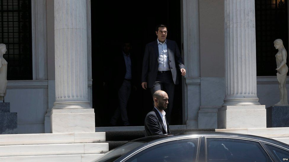 Greek Prime Minister Alexis Tsipras (C, back) leaves his office in Athens, Greece, 09 July 2015