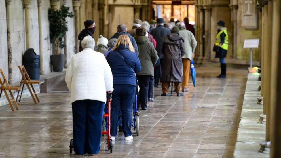 People queuing outside Salisbury cathedral to be vaccinated