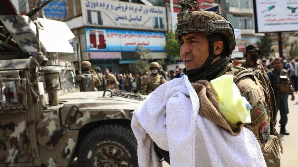 An Afghan soldier shifts a baby at the scene of an attack at MSF (Doctors without Borders) hospital, in Kabul, Afghanistan, 12 May 2020.
