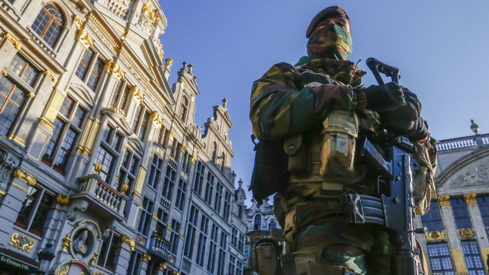 A Belgian soldier patrols the Grand Place in Brussels