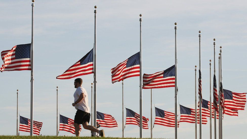 Flags have been lowered to half staff on the Washington Monument grounds to honour those killed by a lone gunman at a night club in Orlando, June, 13, 2016 in Washington, DC