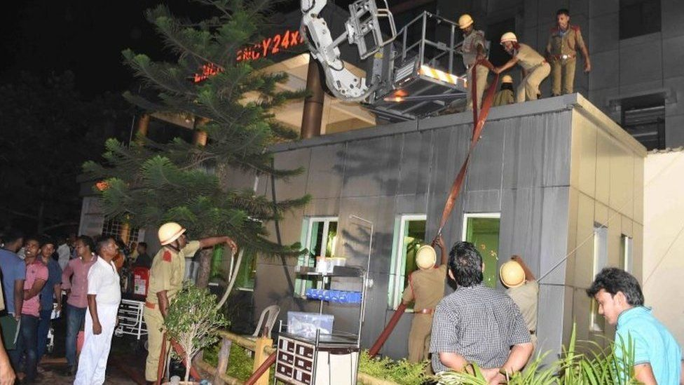 Firefighters try to douse a fire that broke out in the Intensive Care Unit (ICU) of SUM hospital in Bhubaneswar, Orissa, India, 17 October 2016.