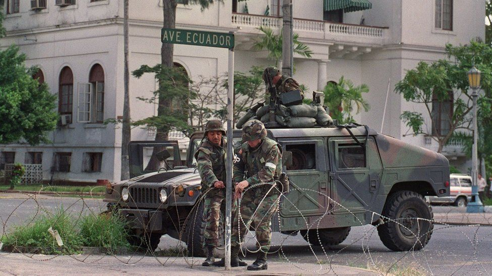 US troops guard the Vatican embassy in Panama City during Operation Just Cause on 25 December, 1989.