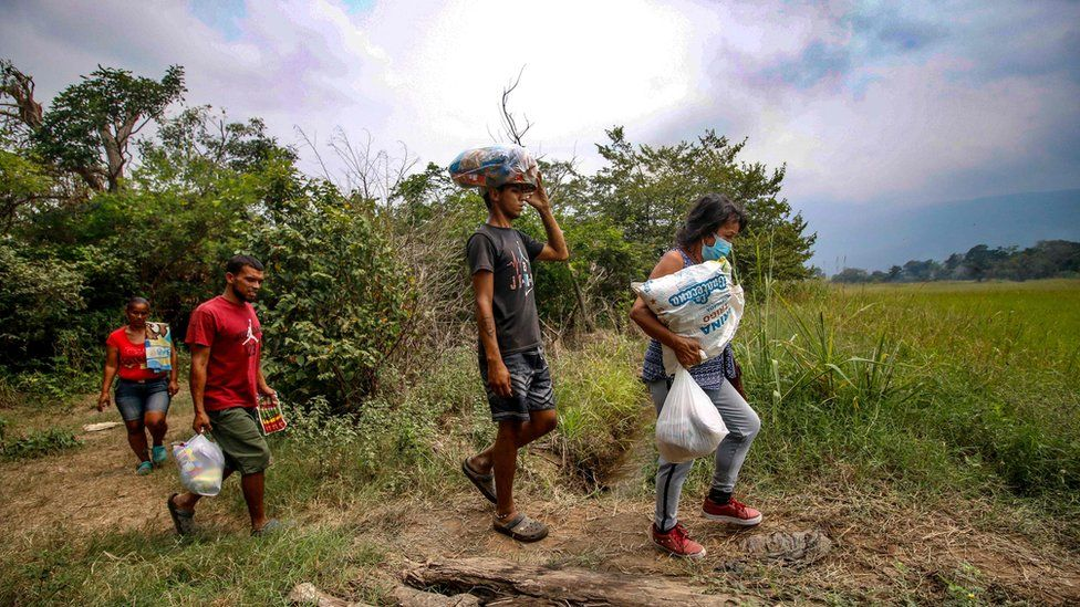 Venezuelan citizens cross from Cucuta in Colombia back to San Antonio del Tachira in Venezuelavia an illegal trail on the border between the two countries
