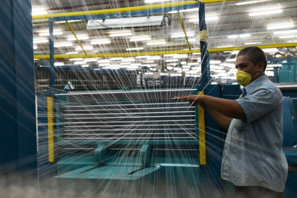 An Indian employee works at a textile factory in Gujarat.