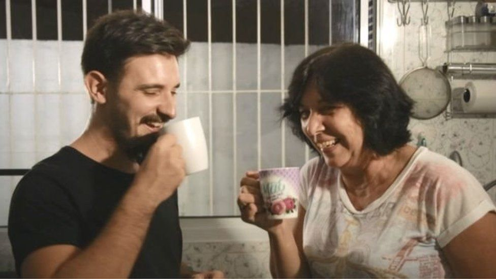 Vitor and his mother share a cup of coffee after an argument about politics