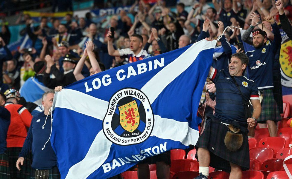 Scotland fans display a flag as they applaud the team following the UEFA Euro 2020 Championship Group D match between England and Scotland at Wembley Stadium