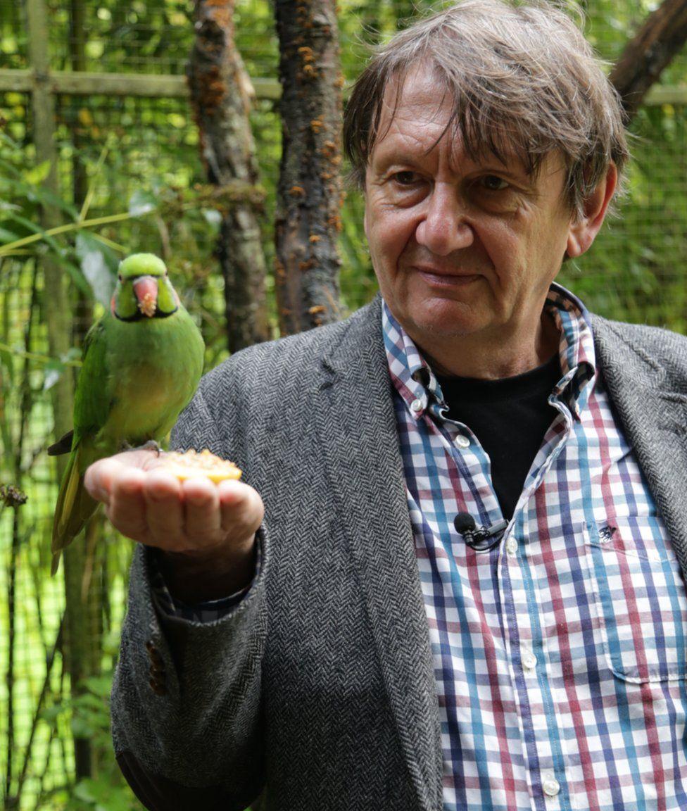 Carl Jones with an echo parakeet