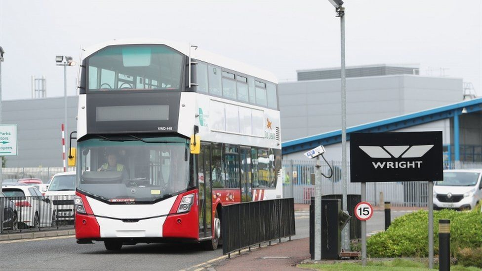 A completed Bus Eireann bus leaves the Wrightbus plant in Ballymena, Northern Ireland