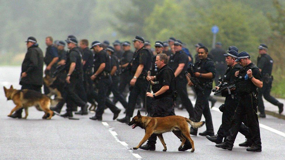 Members of a 450 strong police search team and their dogs begin a search operation in Annersley