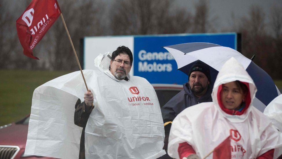 Labour union members block gate 1 of the General Motors Oshawa plant in Oshawa, Ontario, on November 26, 2018. -