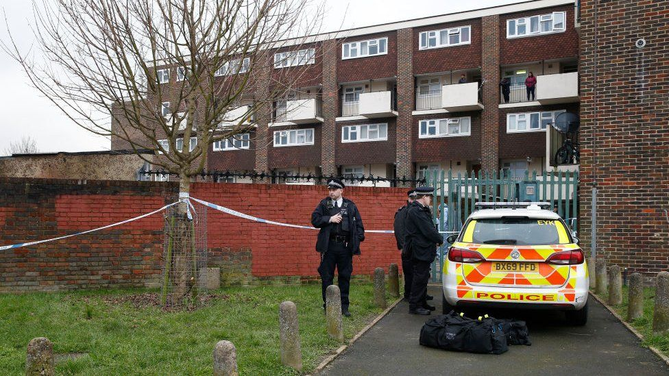 FEBRUARY 06: Police officers at the scene of a fatal stabbing on Wisbeach Road on February 6, 2021 in Croydon, England. A 22-year-old died after an incident at a residential address.