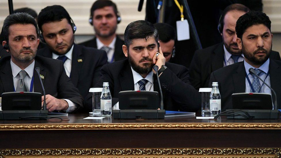 Mohammed Alloush (centre) and other members of Syrian rebel delegation at talks with government in Astana, Kazakhstan (23 January 2017)