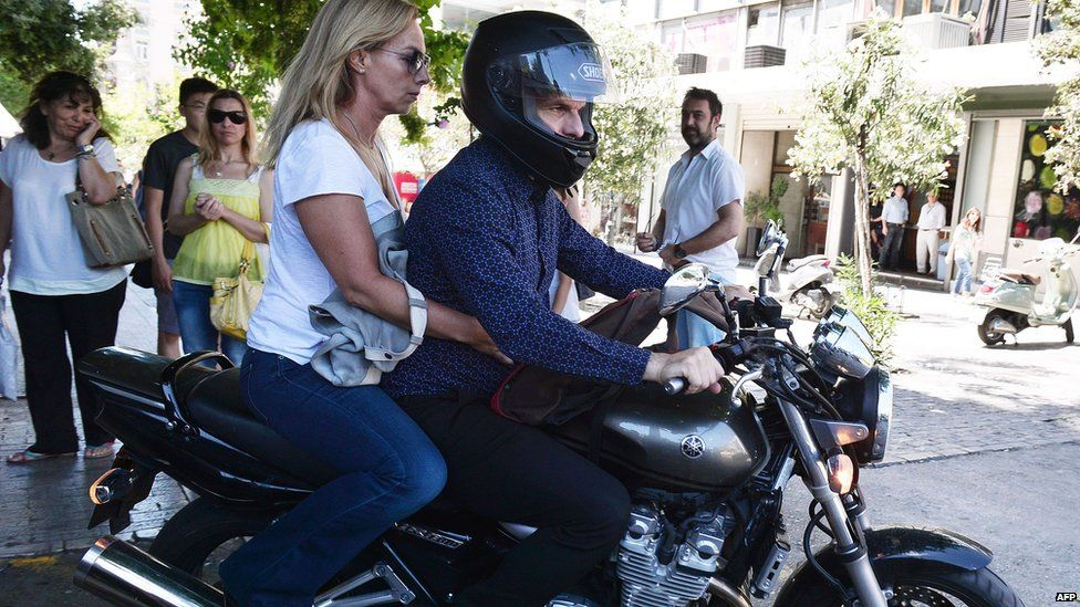 Yanis Varoufakis leaves on his motorcycle with wife Danai after his resignation at ministry of finance. 6 July 2015