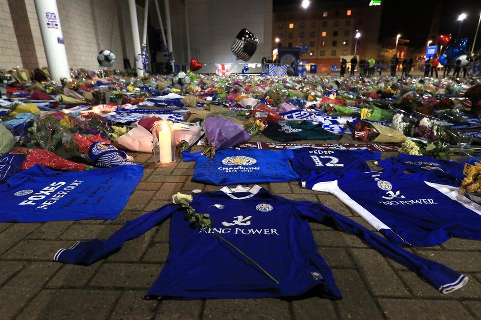Tributes are seen as mourners pause to pay tributes after the helicopter crash at The King Power Stadium on October 28, 2018 in Leicester, England