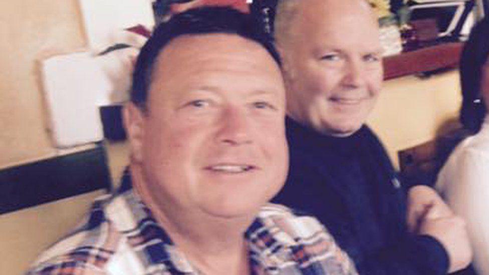 Nigel Dodds (left) with his friend John Scott