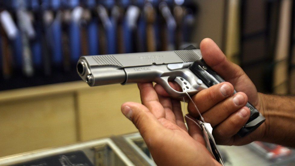A man chooses a gun at the Gun Gallery in Glendale, California, 18 April 2007.