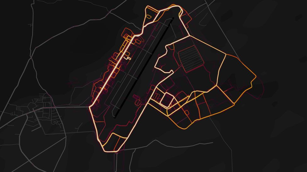 """Red """"heat lines"""" are arrayed neatly in the pattern of roads and streets on a dark black map"""