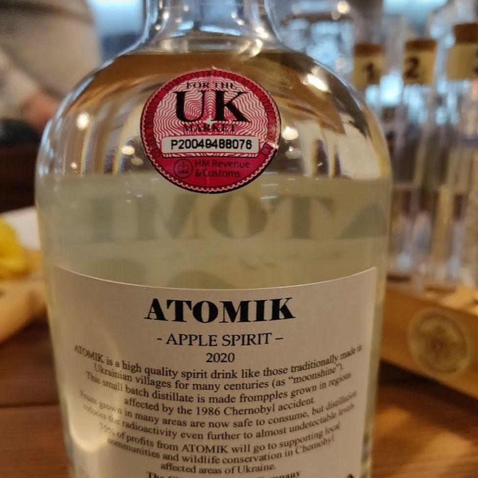 A bottle of Atomik apple spirit with its UK excise stamp
