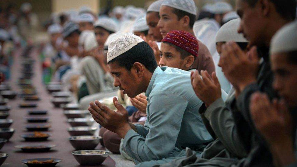 Pakistani Muslims pray before the break of fast at the start of holy month of Ramadan at a mosque in Peshawar on 27 May 2017