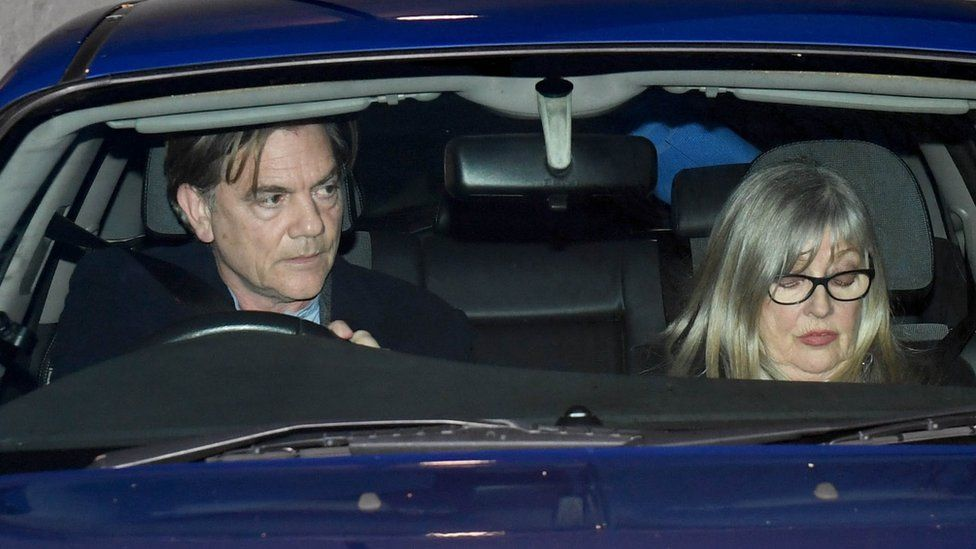 John Michie and Carol Fletcher-Michie leave court in their car
