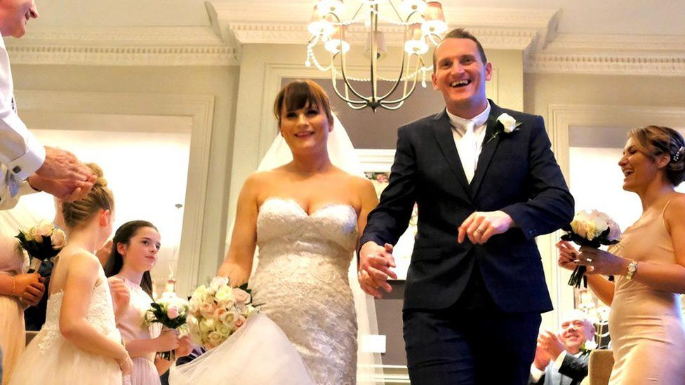 Craig and Kirsty Williams walking down the aisle