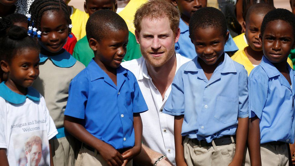 Prince Harry with school children