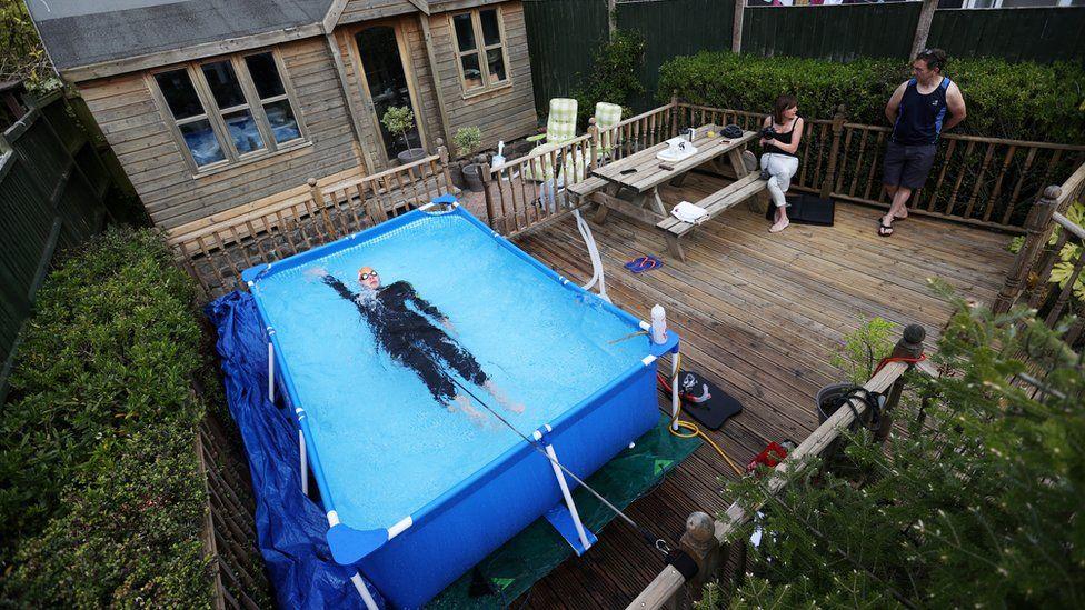 Triathlete Lloyd Bebbington trains in a pool