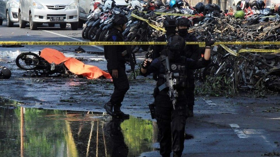 Indonesian police patrol outside a church after a suicide bomb in Surabaya, Indonesia. Photo: 13 May 2018
