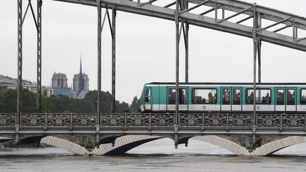 "A Paris subway train passes on the Viaduc d""Austerlitz bridge on June 4, 2016, above the Seine river"