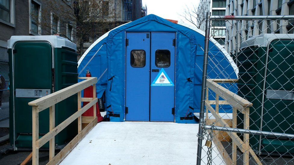 A temporary morgue seen in April set up in front of Mt Sinai Hospital to accommodate the high number of deaths due to the coronavirus
