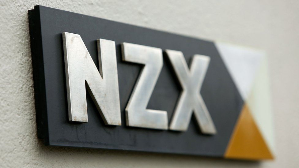 The NZX stock exchange logo is seen on a plaque on a wall in this file photo