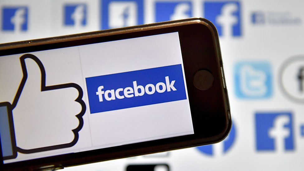 The Facebook logo displayed on a smartphone screen.