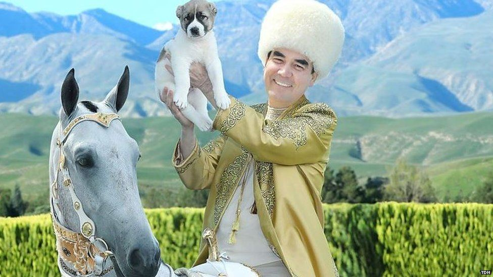 Turkmen leader on horseback holding a puppy