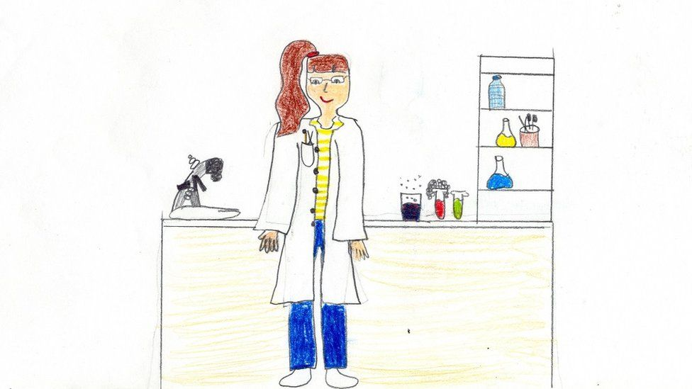 Child's drawing of a scientist with long brown hair, wearing a lab coat and standing next to a microscope