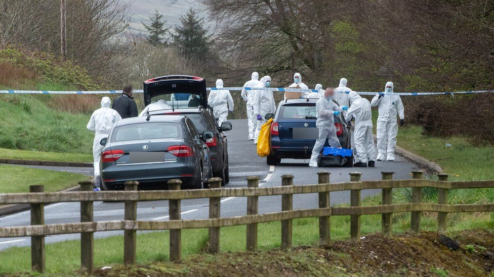 Forensic investigation officers examine the scene of the attempted bomb attack