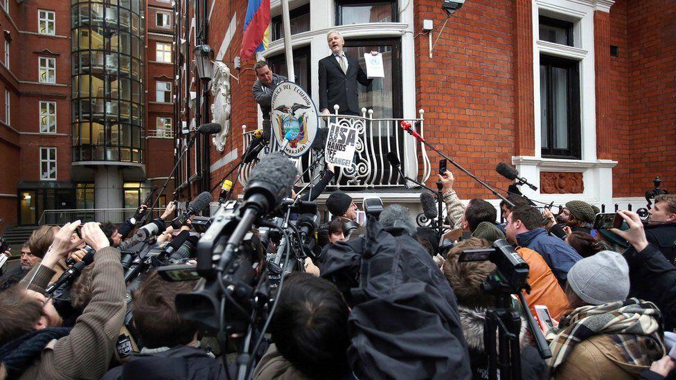 Julian Assange addresses a crowd outside the Ecuadorean embassy